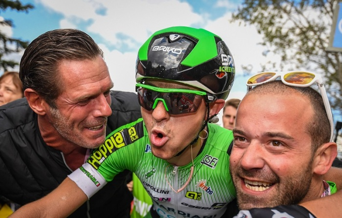 Italian rider Giulio Ciccone of the Bardiani CSF team jubilates with Mario Cipollini (L) after crossing the finish line to win the 10th stage of the Giro d'Italia cycling race over 219km from Campi Bisenzio to Sestola, Italy, 17 May 2016.  ANSA/ALESSANDRO DI MEO