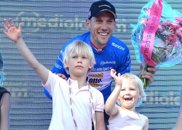 Dutch rider Maarten Tjallingii of the team Lotto Nl Jumbo wears the overall Blu jersey as he celebrates with his son on the podium after the third stage of the Giro d'Italia cycling race over 190km between Nijmegen and Arnhem, Netherlands, 08 May 2016. ANSA/LUCA ZENNARO