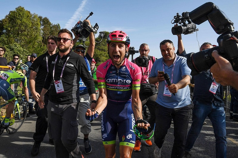 Italian rider Diego Ussi (C) of the Lampre Merida team celebrates after crossing the finish line and win the fourth stage of the Giro d'Italia cycling race over 200 km between Catanzaro and Praia a Mare, Italy 2016. ANSA/ALESSANDRO DI MEO